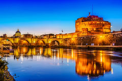 Ponte Saint Angelo bridge crossing the river Tiber,Roma, Italy. Night view over the Tiber river and the Saint Angelo bridge,Roma, Italy royalty free stock image