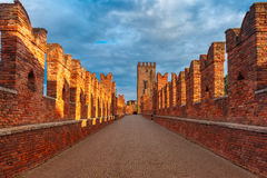 Ponte Scaligero in Verona, Italy. Medieval stone bridge Ponte Scaligero across the river Adige and tower of Castelvecchio in the evening, Verona, Northern Italy Royalty Free Stock Photography