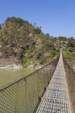 Ponte sospeso rurale, Nepal Immagini Stock