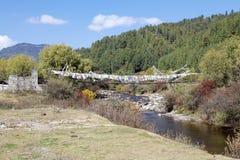 Ponte tibetano in valle di Chhume, Bhutan Fotografia Stock