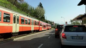Electric Train FLP arriving at Ponte Tresa from Lugano, Switzerland. stock footage