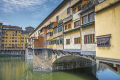 Ponte vecchio across arno river. Florence. Italy. Ponte vecchio across Arno river, Florence, Italy.nA famous old bridge in Florence, full of old goldsmiths and stock image