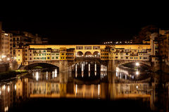 Ponte Vecchio, Arno night, Florence, Firenze Italy. The Ponte Vecchio, the old bridge with its reflection in the  Arno river at night in Firenze, Florence, Italy Stock Image