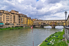 Ponte Vecchio bridge and architecture along river Arno in Florence, Tuscany Royalty Free Stock Photography