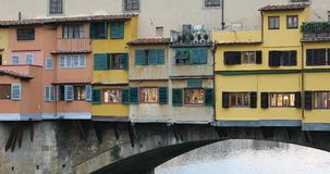 Ponte Vecchio Bridge In The Evening. Florence, Italy - August 31, 2019: Close Up View Of Ponte Vecchio Bridge In The Evening With Colorful Facades And Shutters stock video footage