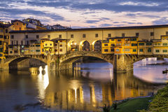 Ponte Vecchio bridge in evening illumination Stock Photos