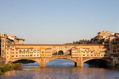 Ponte Vecchio Bridge in Evening Light in Florence, Italy Stock Photo