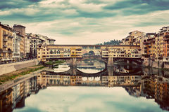Ponte Vecchio bridge in Florence, Italy. Arno River, vintage. Ponte Vecchio bridge in Florence, Italy. Arno River. Retro, Vintage Tuscany royalty free stock photos