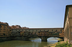 Florence Italy bridge,housing many shops, known as Ponte Veccheo. Ponte Veccheo  is a bridge over the Arno River in Florence Italy where many tourists go to shop Stock Photos