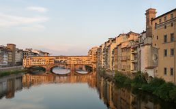 Ponte Vecchio Bridge Florence. Florence, Italy-June 12, 20015.View of the Arno River and the buildings along it`s banks, looking towards the famous Ponte Vecchio Royalty Free Stock Photo