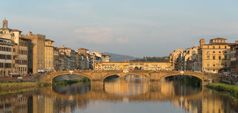 Ponte Vecchio Bridge Florence. Florence, Italy-June 12, 20015.View of the Arno River and the buildings along it`s banks, looking towards the famous Ponte Vecchio Stock Photos