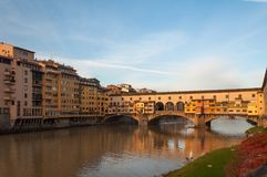 The Ponte Vecchio bridge in Florence, Italy. Panoramic view of the Ponte Vecchio bridge and Arno river in the morning sun in Florence, Italy Stock Photography