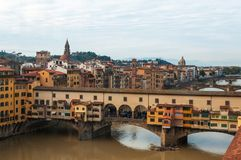The Ponte Vecchio bridge in Florence, Italy. Panoramic view of the Ponte Vecchio bridge and river Arno on a sunny day in Florence, Italy Royalty Free Stock Photo