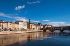 The Ponte Vecchio bridge in Florence, Italy. Panoramic view of the Ponte Vecchio bridge and river Arno on a sunny day in Florence, Italy Stock Images