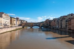 The Ponte Vecchio bridge in Florence, Italy. Panoramic view of the Ponte Vecchio bridge and river Arno on a sunny day in Florence, Italy Royalty Free Stock Photos