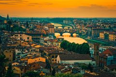 Ponte Vecchio Bridge and Skyline of Florence Italy at Sunset Stock Photography