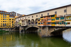 Ponte Vecchio, famous old bridge in Florence on the Arno river, Stock Photo
