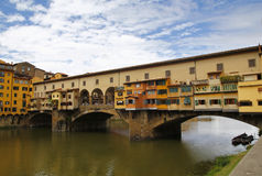 Ponte vecchio in Firenze, Italy. City view of Firenze, the ponte vecchio in the river Arno Royalty Free Stock Photos
