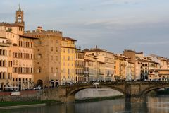 The Ponte Vecchio Bridge is a symbol of the city of Florence. It was built in the XIV century over the river Arno. Evening photo stock images