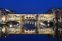 Ponte Vecchio in Florence Italy night scene. Famous bridge Ponte Vecchio in Florence reflecting in Arno river Stock Photo