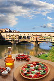 Ponte Vecchio in Florence with pizza royalty free stock photos