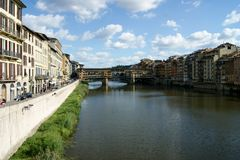 The Ponte Vecchio in Florence. The river Arno on a sunny day Royalty Free Stock Images