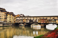 Ponte Vecchio, Florence with reflections in the Arno River Royalty Free Stock Images