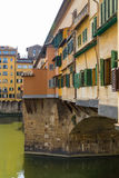 Ponte Vecchio in Florence side on angle. The Ponte Vecchio is a Medieval stone closed-spandrel segmental arch bridge over the Arno River, in Florence, Italy Stock Photos