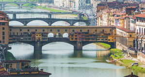 Ponte Vecchio in Florence. With Tourists in a sunny day Stock Photo