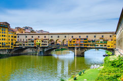 Ponte Vecchio, medieval stone arch bridge over the Arno River and with many small shops along it, Florence, Tuscany. Ponte Vecchio, Old Bridge, medieval stone Royalty Free Stock Photos