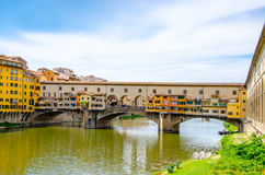 Ponte Vecchio, medieval stone arch bridge over the Arno River and with many small shops along it, Florence, Tuscany. Ponte Vecchio, Old Bridge, medieval stone Stock Images