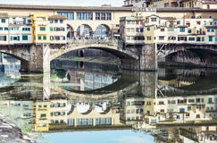 Ponte Vecchio is mirrored in the river Arno, Florence, Italy, cu Stock Photos