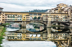 Ponte Vecchio is mirrored in the river Arno, Florence, Italy, cu Stock Photography