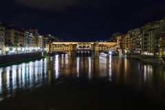Ponte Vecchio in the night stock photography