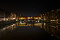 Ponte vecchio by night!. Night photography in Firenze,  Italy.  Reflection of Ponte vecchio on the water of Arne river Stock Photo