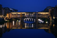 Ponte Vecchio night view. Night view of the Ponte Vecchio (old bridge) over the Arno river, Florence, Italy Stock Image