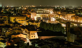 Ponte Vecchio night view over Arno river, Florence Stock Images