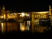 Ponte Vecchio (Old Bridge). The Ponte Vecchio (Italian for Old Bridge), a medieval bridge over Arno River, Florence, Italy, noted for having shops built along it royalty free stock photos