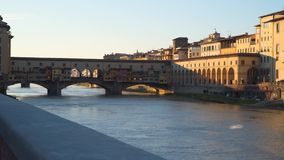 Ponte Vecchio, or old bridge. An everlasting symbol of Florence. Evening time stock video
