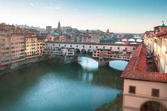 The Ponte Vecchio, old bridge, in Florence in Italy. Historic Italian city, aerial view. royalty free stock photos