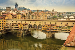 Ponte Vecchio over the Arno River. A bridge with shops on it in Florence, Italy Stock Photos
