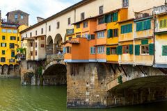 Ponte Vecchio over Arno river in Florence, Italy. Ponte Vecchio over Arno river - famous old bridge in Florence, Italy stock photo