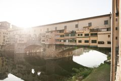 Ponte Vecchio over Arno river in Florence, Italy landscape on a sunny daylight stock photos