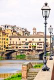The Ponte Vecchio over the river Arno in Florence Stock Photo