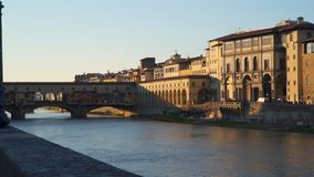 Ponte Vecchio with river Arno at sunset. Florence, Italy stock video