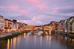 Ponte Vecchio at sunset from Ponte alle Grazie in Florence royalty free stock photos