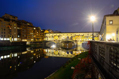 Ponte Vecchio under a clear sky by night Stock Photos