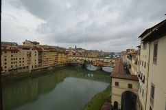 Ponte Vecchio, waterway, sky, town, water. Ponte Vecchio is waterway, water and river. That marvel has sky, city and building and that beauty contains town stock photo