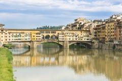 Ponte Veccio Bridge and River Arno, Florence, Italy. Colorful historic houses and Ponte Veccio Bridge reflecting on River Arno, Florence, Tuscany stock photos