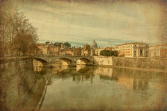 Ponte Vittorio Emanuele II, Rome, Italy. Grunge and retro style. Ponte Vittorio Emanuele II is a bridge in Rome constructed to designs of 1886 by the architect Royalty Free Stock Images